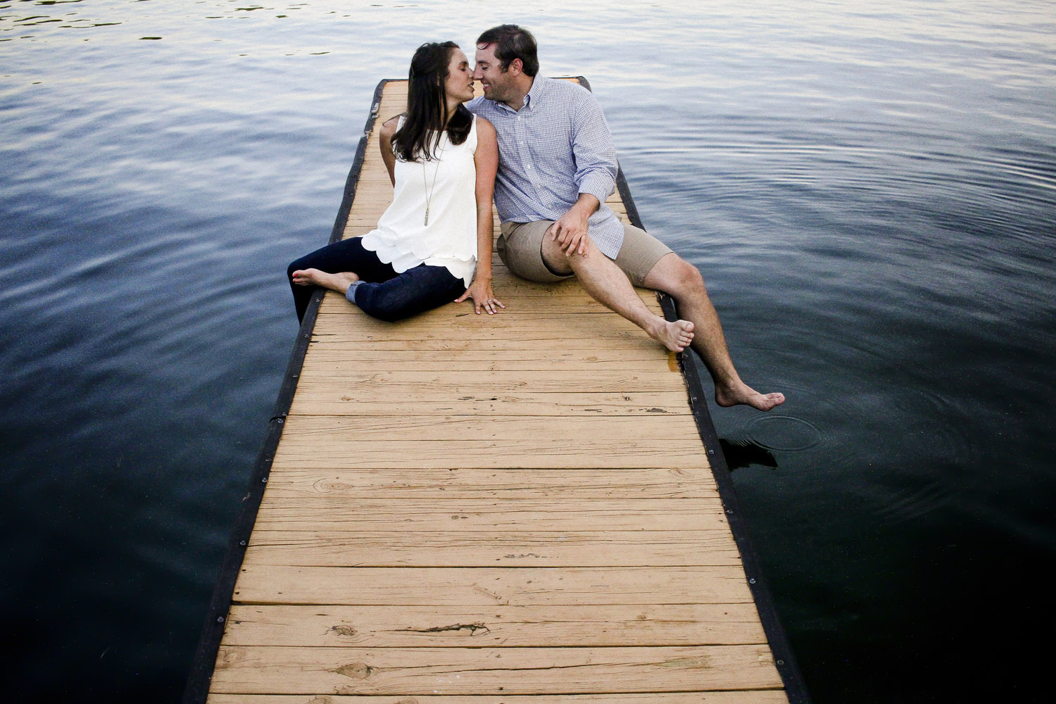 couple kisses on dock