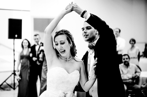 black and white photo of bride and groom dancing at wedding