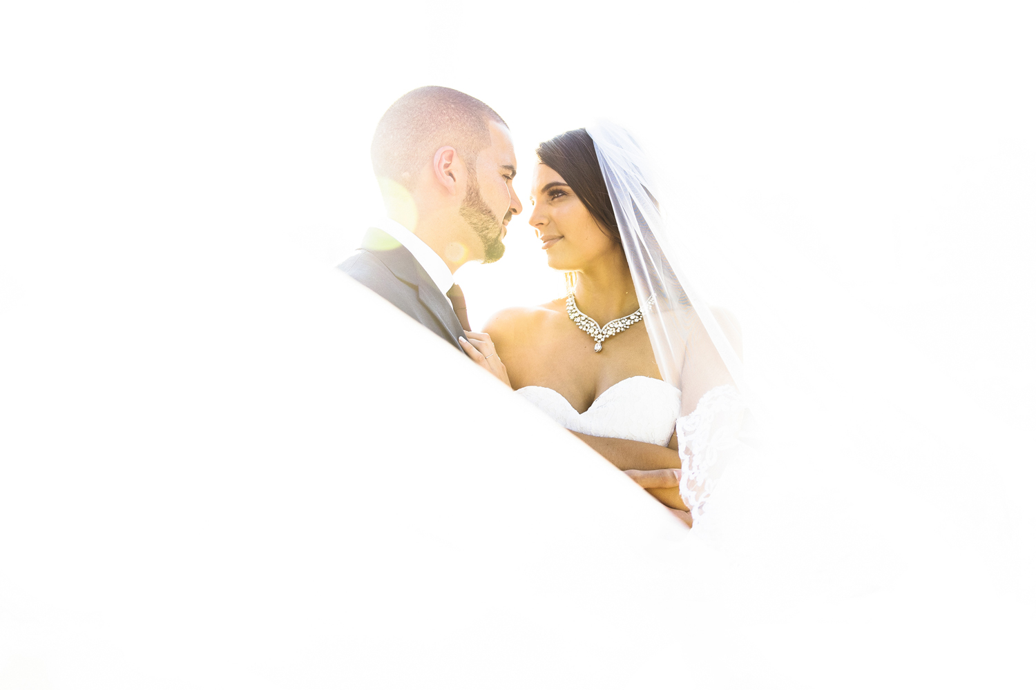 bride and groom in bright white light